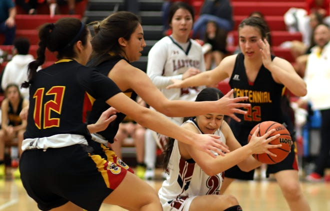 Senior Lady 'Cat Evelyn Ramirez is surrounded by Hawks under the Deming basket.