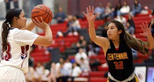 Sophomore vs. sophomore: Lady 'Cat Harmanie Dominguez spots up for a 3-pointer against a closing Larissa Laborin.