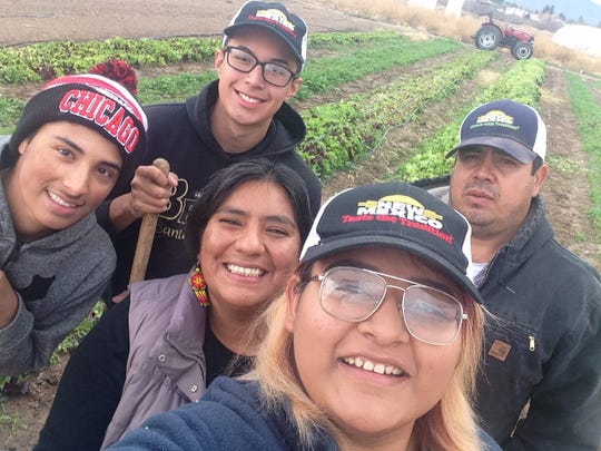Students working at the Anthony Youth Farm pause for a selfie.