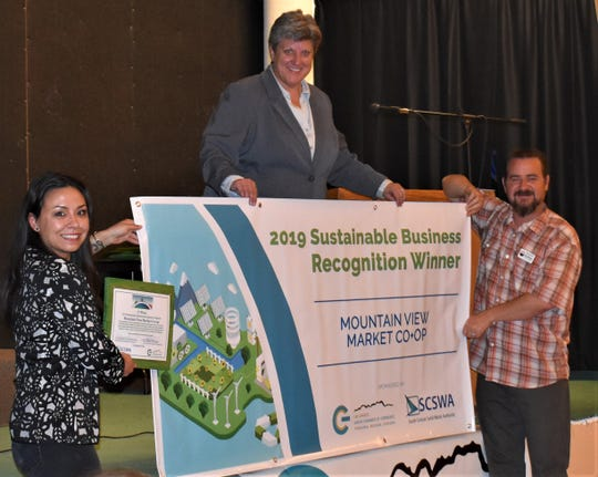 Corrinne Whitmill, Mountain View Market Co+Op's marketing coordinator, accepts the 2019 Sustainable Business of the Year award from Las Cruces Green Chamber of Commerce CEO/President Carrie Hamblen and Board of Directors Chair Corey Asbill at the 2019 LCGCC Annual Membership Party. Applications for the 2020 Sustainable Business are being accepted now through the end of March.