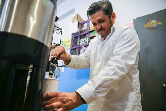 Frank Jaurequi, owner of Downtown Blues Coffee, pours a cup of coffee Saturday, Feb. 15, 2020, at his new shop on Main Street in Downtown Las Cruces