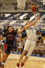 Carlsbad's Evan Sullivan is fouled while shooting a layup against Roswell on Feb. 14, 2020. Roswell won in overtime, 56-49.