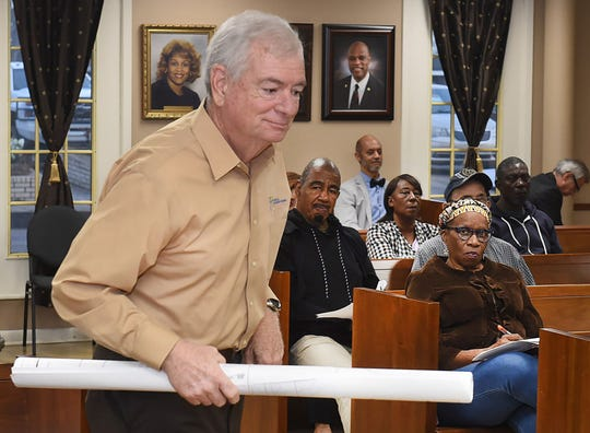 Demographer Mike Hefner returns to his seat after presenting 2020 census information to the Opelousas Board of Aldermen.