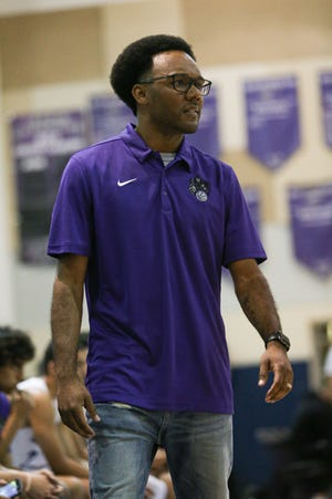 Shadow Hills head coach Ryan Towner paces the sidelines during his team's 85-37 Friday's home playoff game against Ontario Christian.