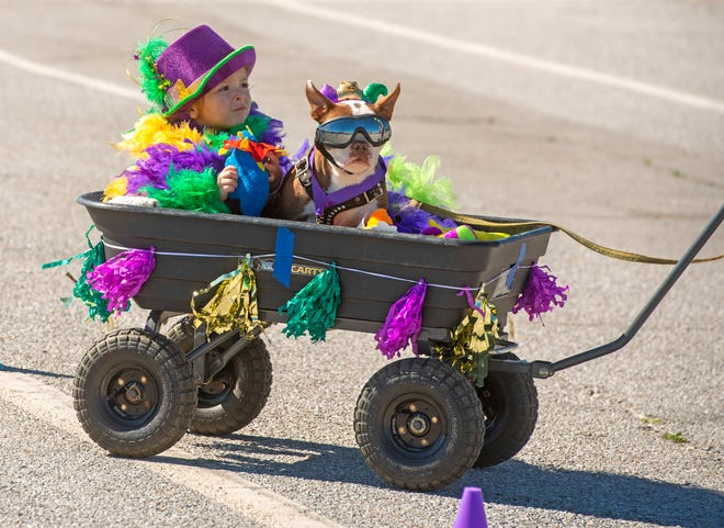 Young revelers made their way to the 10th annual Kids and Kritters Parade at Pensacola Beach on Saturday, Feb. 15, 2020. The parade is one for the smallest Mardi Gras revelers with dogs, horses, ponies and goats and, of course, beads and candy.