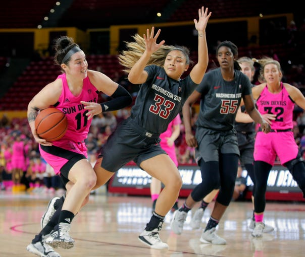 Arizona State Sun Devils guard Robbi Ryan (11) is fouled by Washington State Cougars guard Cherilyn Molina (33) during a women's basketball game at ASU Desert Financial Arena in Tempe on February 14, 2020.
