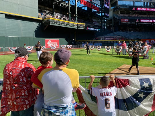 Fans of all ages take a crack at Wiffle ball home-run derby in the outfield at Chase Field during the D-backs 2020 Fan Fest, Saturday, Feb. 15.