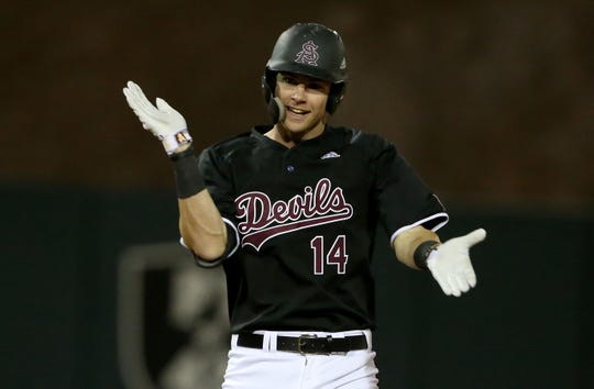 ASU third baseman Gage Workman (14) celebrates getting the Sun Devils first in double against Villanova during the second round at Phoenix Municipal Stadium Tempe on February 14, 2020.
