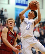 Cedar Crest's Amani Jones (2) lays in two over Warwick's Tate Landis (0) during fourth quarter action.