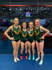 The Franklin D. Roosevelt girls distance medley relay team of Lindsay Holland, Alex North, Alexis Nordmann and Sarah Trainor pose after taking fourth in the North Shore Pre-National Invitational on Feb. 14 at The Armory.