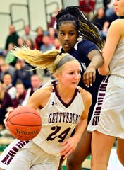 Gettysburg's Anne Bair, seen here at left in a file photo, scored 14 points on Tuesday night in the Warriors' win over West York.