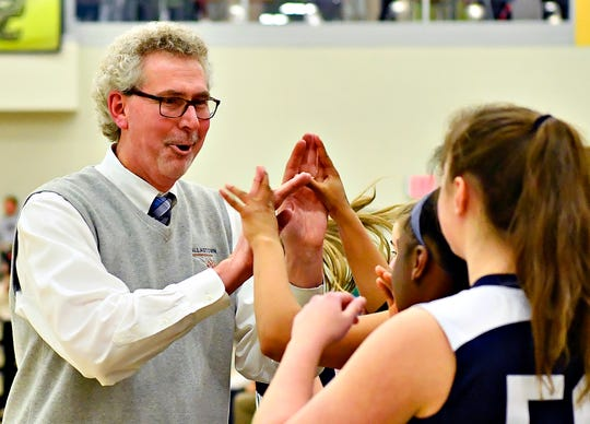 Dallastown's Head Coach Jay Rexroth hands out high-fives on the sideline with seconds on the clock during YAIAA girls' basketball championship action against Gettysburg at Grumbacher Sport and Fitness Center at York College of Pennsylvania in Spring Garden Township, Friday, Feb. 14, 2020. Dallastown would win the game 42-38. Dawn J. Sagert photo