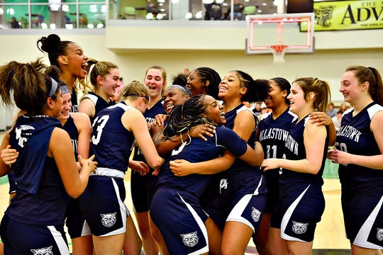 Dallastown celebrates a 42-38 win over Gettysburg during YAIAA girls' basketball championship action at Grumbacher Sport and Fitness Center at York College of Pennsylvania in Spring Garden Township, Friday, Feb. 14, 2020. Dawn J. Sagert photo