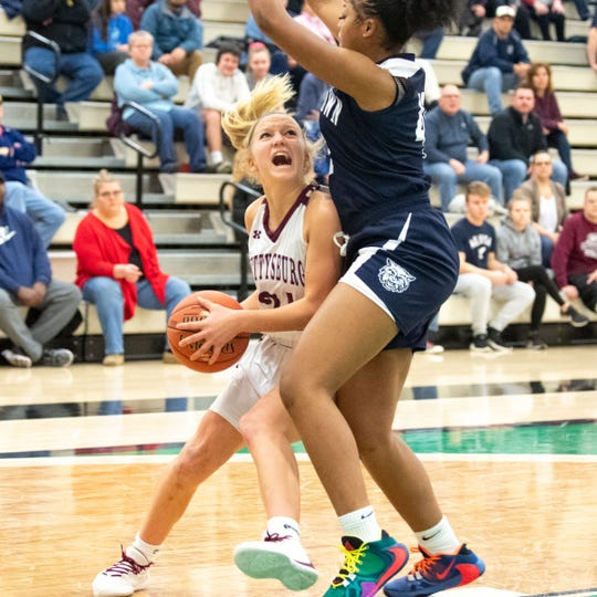 Anne Blair (24) drives the lane during the YAIAA girls title game between Dallastown and Gettysburg at York College. The Wildcats lead the Warriors 23-15 at halftime.