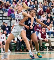 Lily Natter (13) and Bria Beverly (41) fight for position during the YAIAA girls title game between Dallastown and Gettysburg in the Charles Wolf Gym at York College, Friday, February 14, 2020. The Wildcats defeated the Warriors 42-38.