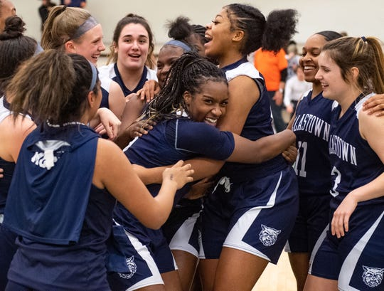 Dallastown players celebrate after defeating Gettysburg 42-38 to win the YAIAA title in Charles Wolf Gym at York College Thursday, February 14, 2020. The Wildcats defeated the Warriors 42-38.