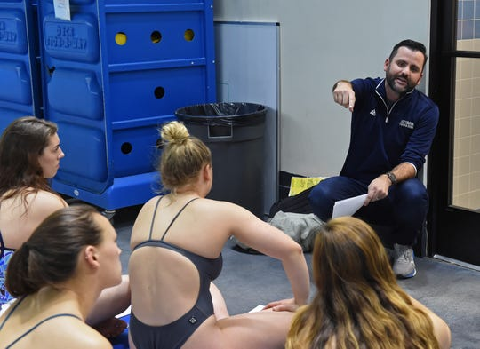 Nevada swim head coach Brendon Bray talks to the swimmers on their upcoming trip to the Mountain West Championships.