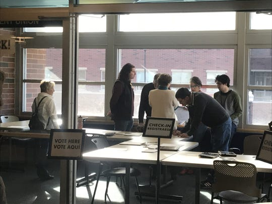 Washoe County Democratic Party staffers prepare to open the polls at UNR's Joe Crowley Student Union on Saurday, Feb. 15, 2020.