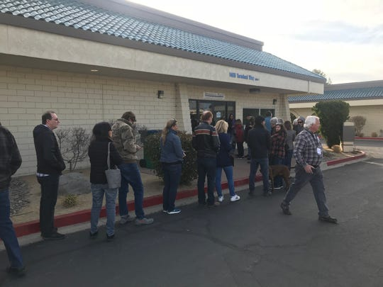 Caucusgoers form a line at Washoe County Democratic Party headquarters on Saurday, Feb. 15, 2020.
