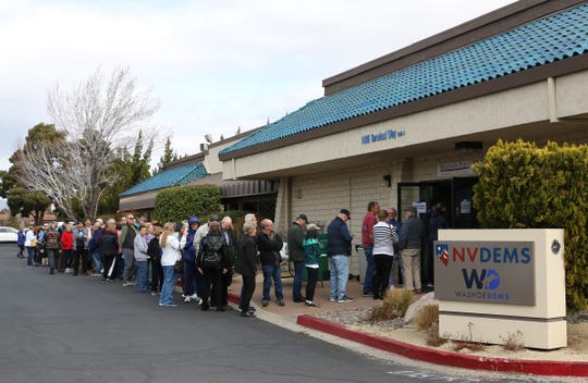 People participate in early caucus voting at the Washoe County Democratic Headquarters in Reno on Feb. 15, 2020.