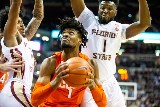 Syracuse forward Quincy Guerrier (1) goes back up for a second shot against Florida State forward RaiQuan Gray (1) and guard Travis Light (20) in the first half of an NCAA college basketball game in Tallahassee, Fla., Saturday, Feb. 15, 2020.