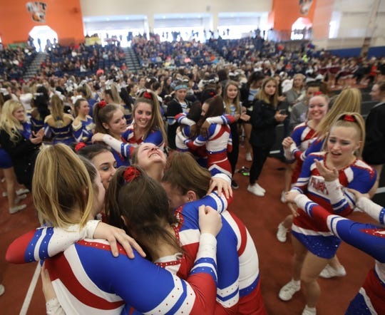 Fairport cheerleaders celebrate after winning the Division 1 Small Schools class at the Section V Winter Cheerleading Championships held at RIT on Saturday, Feb. 15.