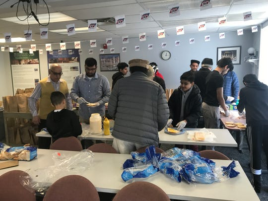 Members of Rochester's Ahmadiyya Muslim Community chapter assemble food for donation to a local shelter.