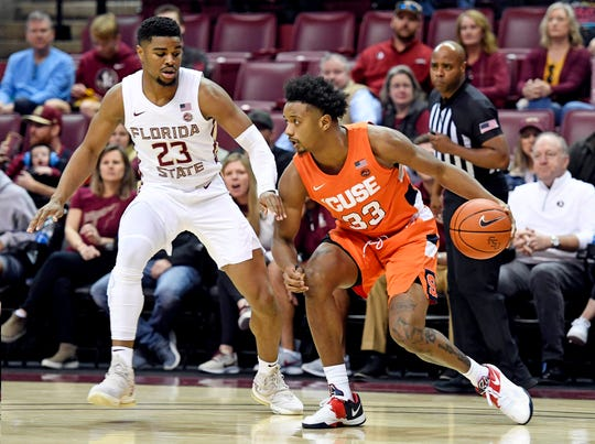 Florida State's  MJ Walker (23) defends Syracuse Orange forward Elijah Hughes (33) during the first half at Donald L. Tucker Center. Hughes scored 25 points in an 80-77 loss.