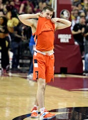Syracuse guard Joseph Girard III (11) reacts after Saturday's 80-77 loss to Florida State.