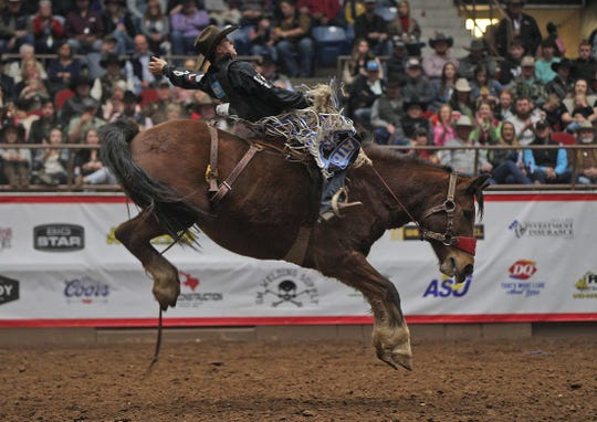 Zeke Thurston competes in the saddle bronc event at the San Angelo Stock Show and Rodeo on Friday, Feb. 14, 2020.