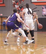Mason's Tristin Keller, right, tries to get past San Saba defender Courtnee Cash, in back, while Mason's McKenzie Cano (44) screens as No. 6 San Saba defeated No. 5 Mason 28-26 to win the the District 27-2A girls basketball championship game Friday, Feb. 14, 2020, at Llano High School.