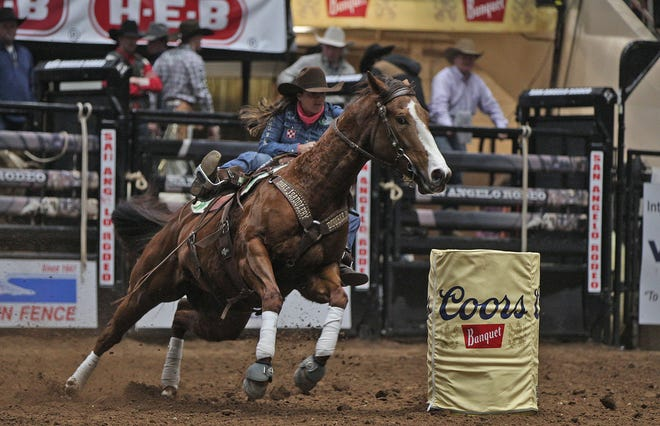 Brittany Pozzi Tonozzi competes in the barrel racing event at the San Angelo Stock Show and Rodeo on Friday, Feb. 14, 2020.