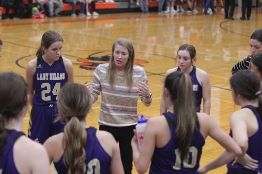 San Saba High School girls basketball head coach Alicia Cummings talks things over with her team during the District 27-2A girls basketball championship game against Mason Friday, Feb. 14, 2020, at Llano High School.