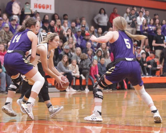 Mason's Aunnecy Elliott tries to penetrate the defensive front of San Saba's Courtnee Cash (14) and Kylee Eckermann (5) as No. 6 San Saba defeated No. 5 Mason 28-26 to win the the District 27-2A girls basketball championship game Friday, Feb. 14, 2020, at Llano High School.