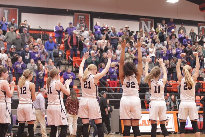 The Mason girls acknowledge their crowd of fans during introductions before the game as No. 6 San Saba defeated No. 5 Mason 28-26 to win the the District 27-2A girls basketball championship game Friday, Feb. 14, 2020, at Llano High School.