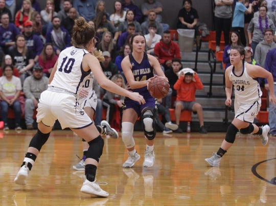 Mason's Sterling Smith (10) and Jesse Armstrong (34) close in on San Saba's Courtnee Cash as No. 6 San Saba defeated No. 5 Mason 28-26 to win the the District 27-2A girls basketball championship game Friday, Feb. 14, 2020, at Llano High School.