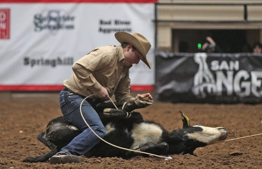 Ty Harris competes in the tie down roping event at the San Angelo Stock Show and Rodeo on Friday, Feb. 14, 2020.
