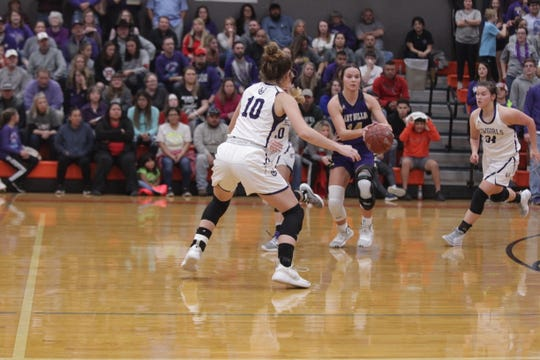 San Saba High School's Courtnee Cash (middle) pushes the ball up the court against the defensive pressure of Mason's Sterling Smith (10 and Jesse Armstrong (34) in the District 27-2A girls basketball championship game Friday, Feb. 14, 2020, at Llano High School.