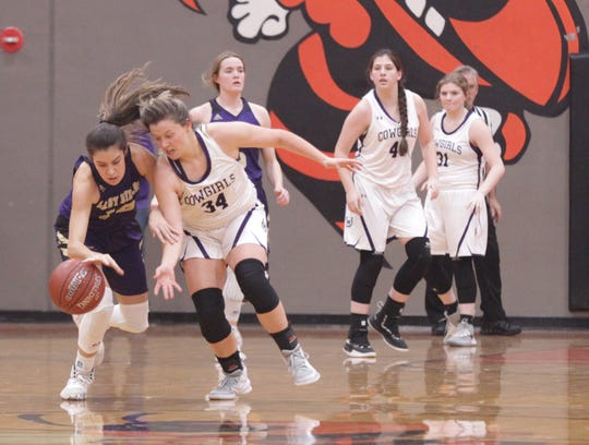 San Saba's Brighton Adams, left, fights to recover the ball after it was swatted loose by Mason's Jesse Armstrong (34) as No. 6 San Saba defeated No. 5 Mason 28-26 to win the the District 27-2A girls basketball championship game Friday, Feb. 14, 2020, at Llano High School.