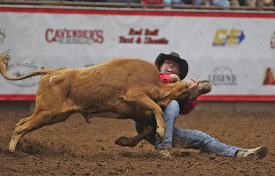 Matt Reeves competes in the steer wrestling event at the San Angelo Stock Show and Rodeo on Friday, Feb. 14, 2020.