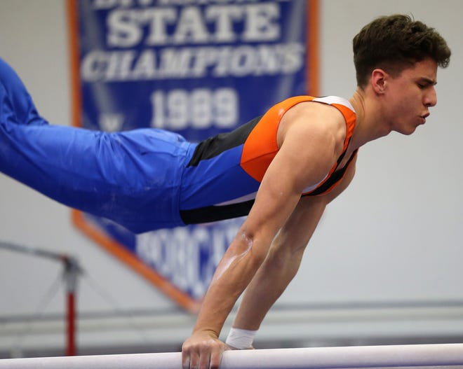San Angelo Central High School's Caiden Hernandez competes on parallel bars earlier in the 2019-2020 season.