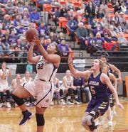Mason's Lauren Olson (32) goes in for a layup as San Saba's Kylee Eckermann (5) follows as No. 6 San Saba defeated No. 5 Mason 28-26 to win the the District 27-2A girls basketball championship game Friday, Feb. 14, 2020, at Llano High School.