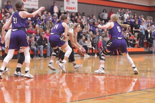 San Saba's Courtnee Cash (14) and Kylee Eckermann (5) close in on a Mason ball handler in the District 27-2A girls basketball championship game Friday, Feb. 14, 2020, at Llano High School.