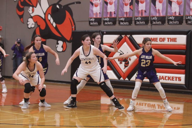Mason High School's McKenzie Cano (44) battles for position against the San Saba defense in the District 27-2A girls basketball championship game Friday, Feb. 14, 2020, at Llano High School.