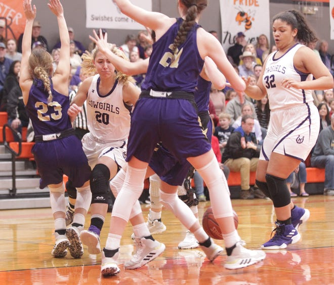 Mason's Tristin Keller (20) loses the ball as she moves into traffic provided by San Saba defenders Braycie Vickery (23) and Landri Glover (21) as No. 6 San Saba defeated No. 5 Mason 28-26 to win the the District 27-2A girls basketball championship game Friday, Feb. 14, 2020, at Llano High School.