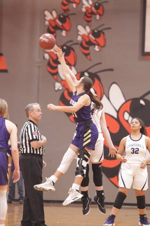 San Saba's Courtnee Cash, purple, tips off the game with Mason's McKenzie Cano as No. 6 San Saba defeated No. 5 Mason 28-26 to win the the District 27-2A girls basketball championship game Friday, Feb. 14, 2020, at Llano High School.