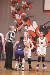 San Saba's Courtnee Cash, purple, and Mason's McKenzie Cano, white, eye the ball as they get ready to tip off the game as No. 6 San Saba defeated No. 5 Mason 28-26 to win the the District 27-2A girls basketball championship game Friday, Feb. 14, 2020, at Llano High School.