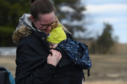 Jenny O'Donnell waits with her 4-month-old Tyler for the NG-13 rocket launch at NASA Wallops on Friday, Feb. 14, 2020. The launch ended up being scrubbed Friday, however, and her family returned yet again Saturday to see their first successful launch in-person.
