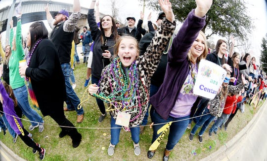Adysen Breeland tries to get beads during the 29th Annual Krewe of Centaur Parade: Centaur Time Travels! Saturday afternoon on Clyde Fant Parkway in downtown Shreveport.