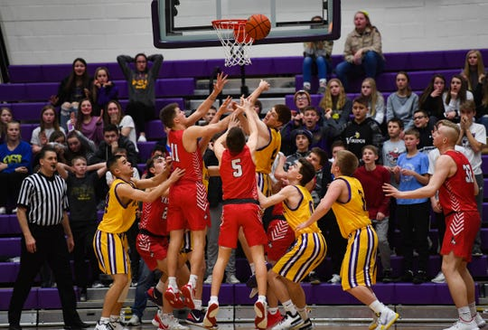 Yankton and Watertown players scramble to catch consecutive rebounds at the Yankton hoop in the final seconds of the game on Friday, Feb. 14, at the Watertown Civic Arena.